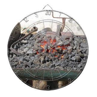 Old-fashioned blacksmith furnace . Burning coals Dartboard