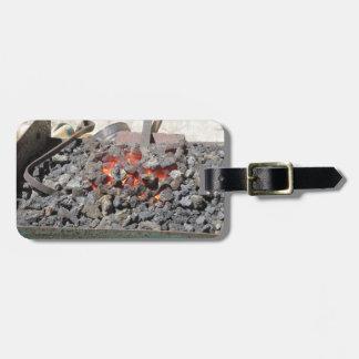 Old-fashioned blacksmith furnace . Burning coals Luggage Tag