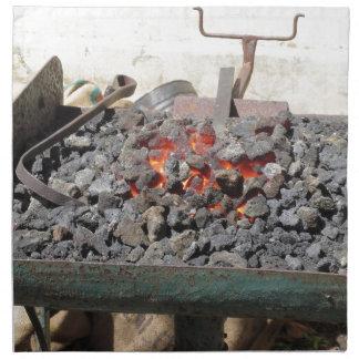 Old-fashioned blacksmith furnace . Burning coals Napkin