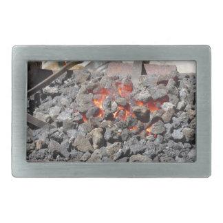 Old-fashioned blacksmith furnace . Burning coals Rectangular Belt Buckle