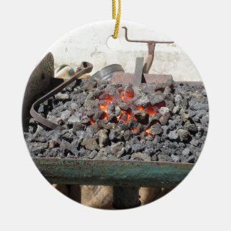 Old-fashioned blacksmith furnace . Burning coals Round Ceramic Decoration