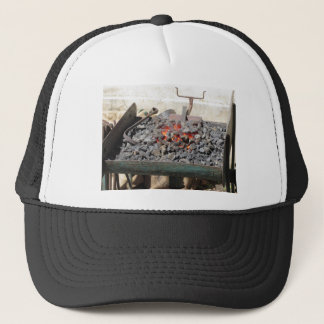 Old-fashioned blacksmith furnace . Burning coals Trucker Hat