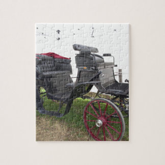 Old-fashioned horse carriage on green grass jigsaw puzzle