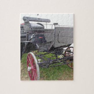 Old-fashioned horse carriage on green grass puzzle