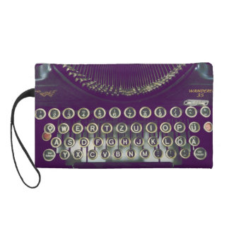 old fashioned typewriter wristlet clutches