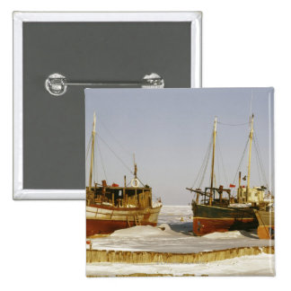 Old-fashioned, weathered fishing boats beached 15 cm square badge