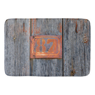 Old Grunge Rusty Metal House Number No. 87 Photo - Bath Mat
