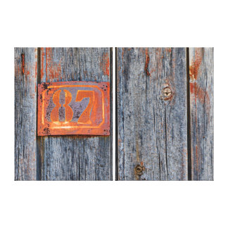 Old Grunge Rusty Metal House Number No. 87 Photo . Canvas Print