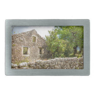 Old historic house as ruins along road belt buckle