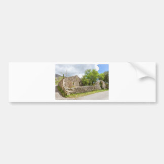 Old historic house as ruins along road bumper sticker