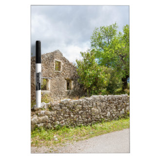 Old historic house as ruins along road dry erase board