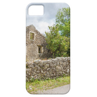 Old historic house as ruins along road iPhone 5 cover