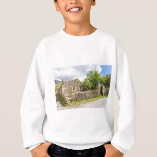 Old historic house as ruins along road sweatshirt