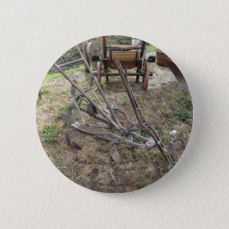 Old iron plow and other agricultural tools 6 cm round badge