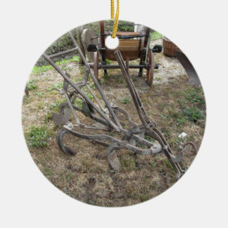 Old iron plow and other agricultural tools ceramic ornament