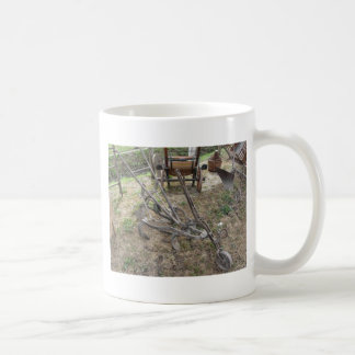 Old iron plow and other agricultural tools coffee mug