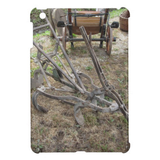 Old iron plow and other agricultural tools cover for the iPad mini