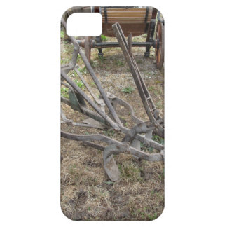 Old iron plow and other agricultural tools iPhone 5 cover