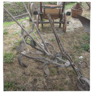 Old iron plow and other agricultural tools napkin