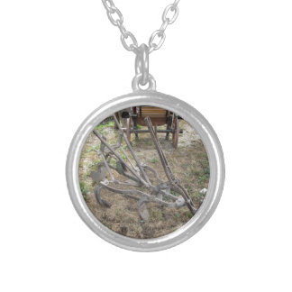 Old iron plow and other agricultural tools silver plated necklace