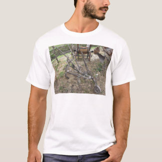 Old iron plow and other agricultural tools T-Shirt