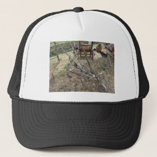 Old iron plow and other agricultural tools trucker hat