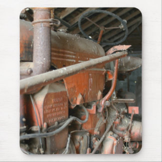 Old red tractor in a barn mouse pad