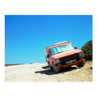 Old red truck on a desert island postcard