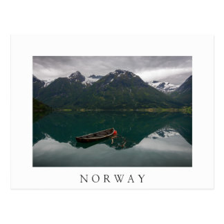 Old rowboat and mountain in Norway white postcard