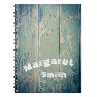 Old, rustic, wooden wall notebook with your name
