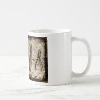 Old rusty tools. coffee mugs