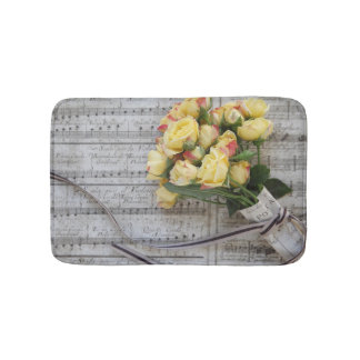Old sheet music with yellow roses bath mat