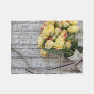 Old sheet music with yellow roses fleece blanket