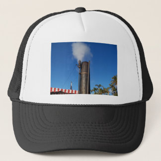 old steam whistle with a white plume of steam trucker hat