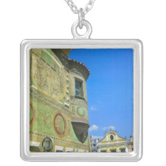 Old town square surrounded by 16th-century square pendant necklace