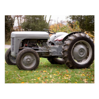Old tractor in fall postcards