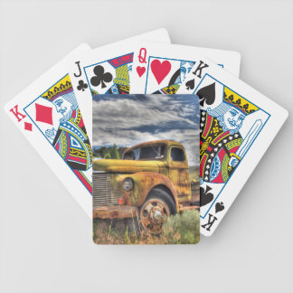 Old truck abandoned in field bicycle playing cards