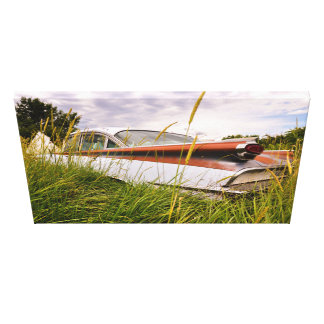 Old vintage car resting in the grass canvas print