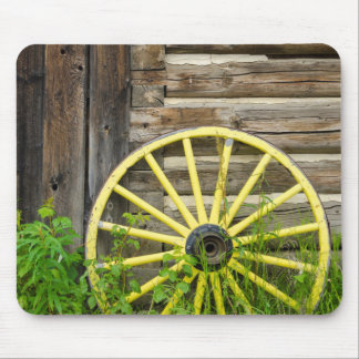 Old wagon wheel in historic old gold town mouse pad