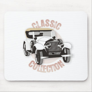 Old white vintage car with hard top roof mousepads