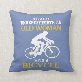 OLD WOMAN WITH A BICYCLE CUSHION