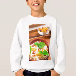 Old wooden bowl of healthy oatmeal with berries sweatshirt