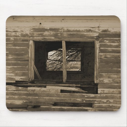 Old wooden building broken out window sepia tone mousepad