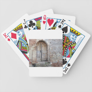 Old wooden door in old brick wall bicycle playing cards