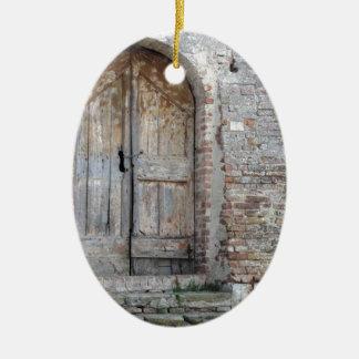 Old wooden door in old brick wall ceramic ornament