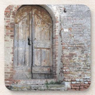 Old wooden door in old brick wall coaster