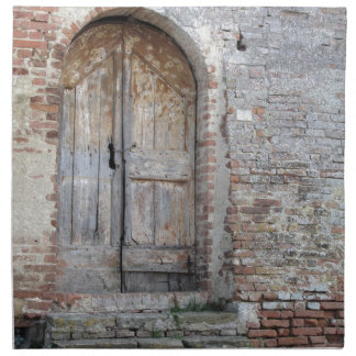 Old wooden door in old brick wall napkin