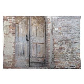Old wooden door in old brick wall placemat