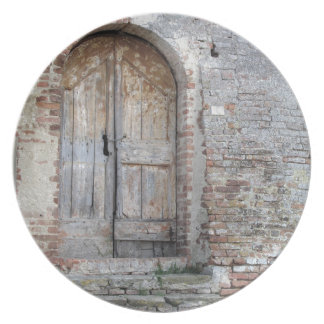 Old wooden door in old brick wall plate