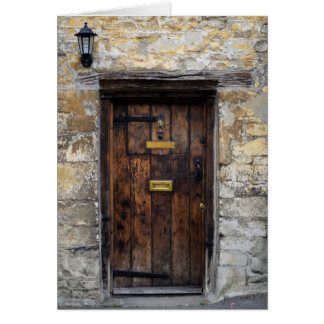 Old wooden front door with light card